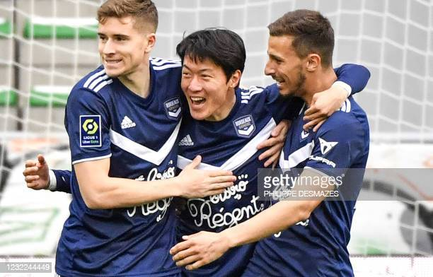 Bordeaux' South Korean forward Ui-Jo Hwang is congratuled by team mates after scoring a goal during the French L1 football match between AS...