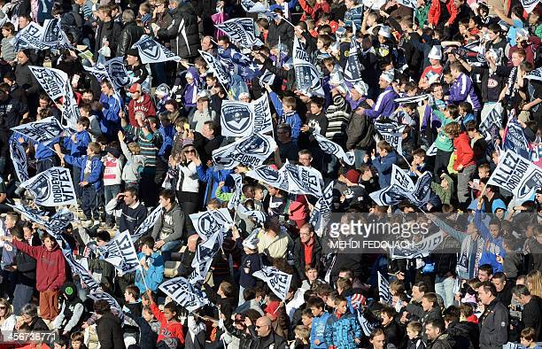Bordeaux supporters cheer on their team before a French L1 football match Bordeaux vs Valenciennes on december 15 2013 at ChabanDelmas stadium in...