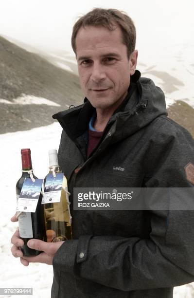 Bordeaux winemaker Franck Labeyrie poses with bottles of his wine in Cauterets Pyrenees southern France on June 7 2018 Labeyrie has recovered his...