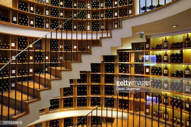 Bordeaux wines cover the shelves at the L'Intendant Grands Vins de Bordeaux wine shop on June 29 2018 in Bordeaux France L'Intendant is considered...