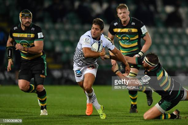 Bordeaux-Begles' Argentinian wing Santiago Cordero avoids a tackle from Northampton Saints' English flanker Tom Wood during the European Rugby...
