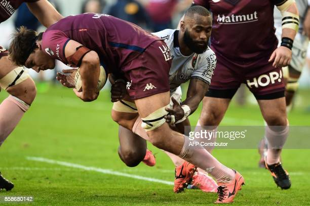 BordeauxBegles' Australian lock Luke Jones is tackled by RC Toulon's Fijian winger Semi Radradra during the French Top 14 rugby union match between...
