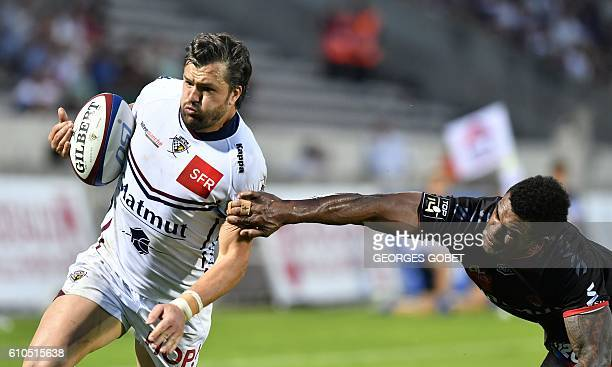 BordeauxBegles' Australian wing Adam AshleyCooper scores a try during the French Top 14 rugby union match between BordeauxBegles and Lyon on...