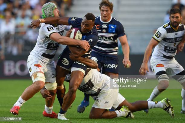 BordeauxBegles' Australian wing Eto Nabuli is tackled during the French Top 14 rugby union match between BordeauxBegles and La Rochelle on September...