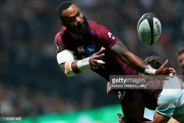 Bordeaux-Begles' Fijian centre Semi Radradra passes the ball during the French Top 14 rugby union match between Racing Metro 92 and Bordeaux-Begles...