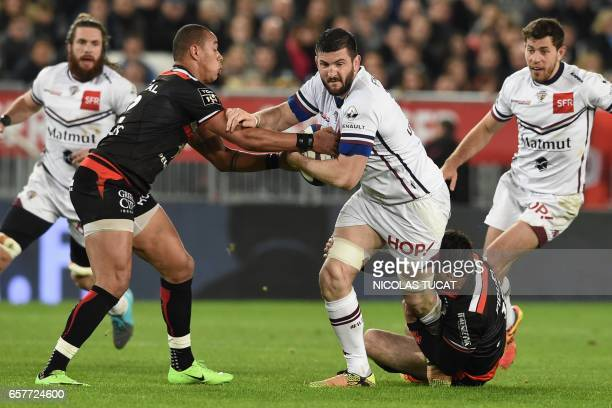 BordeauxBegles' French flanker Loann Goujon vies with Toulouse's French centre Gael Fickou during the French Top 14 rugby union match between...