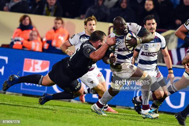 BordeauxBegles' French flanker Mahamadou Diaby is tackled during the French Top 14 rugby union match between BordeauxBegles and Brive on November 25...
