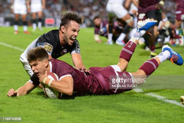Bordeaux-Begles' French flyhalf Matthieu Jalibert scores a try during the French Top14 rugby union match between Bordeaux-Begles and Toulouse at the...