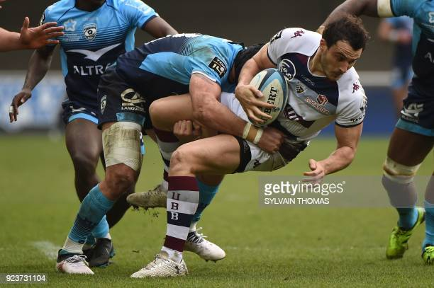 BordeauxBegles' French fullback Nans Ducuing is tackled by Montpellier's French number eight Alexandre Dumoulin during the French Top 14 rugby union...