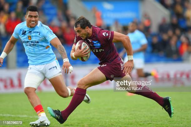 Bordeaux-Begles' French fullback Nans Ducuing runs to score a try during the French Top 14 rugby union match between Bordeaux-Begles and Perpignan on...