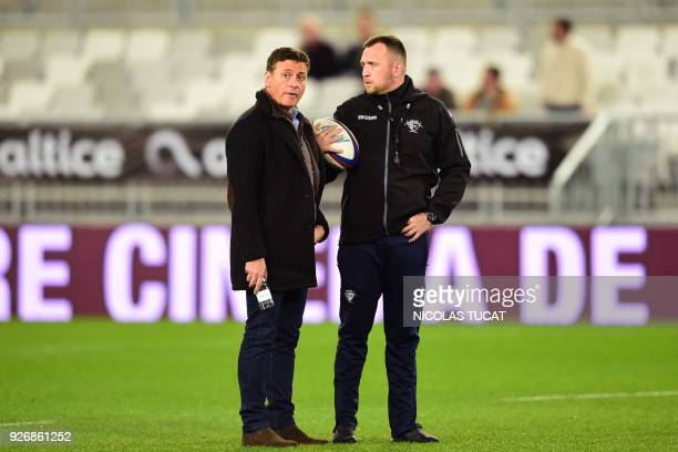BordeauxBegles' French president Laurent Marti talks to BordeauxBegles' English head coach Rory Teague during the French Top 14 rugby union match...