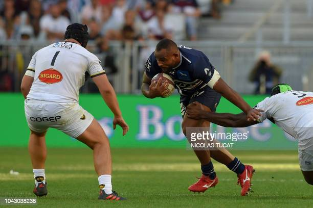 BordeauxBegles' French prop Jefferson Poirot runs with the ball during the French Top 14 rugby union match between BordeauxBegles and La Rochelle on...