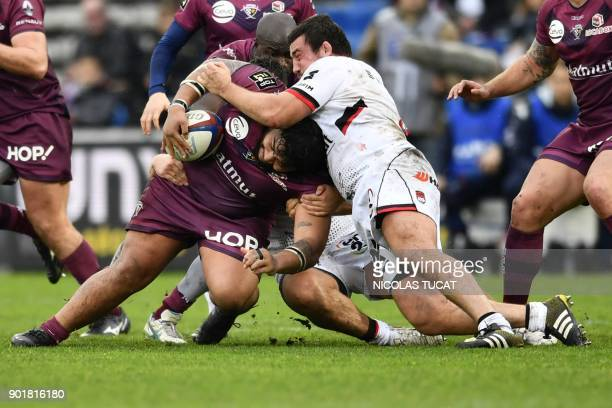 BordeauxBegles' French prop Sebastien Taofifenua is tackled during the French Top 14 rugby union match between BordeauxBegles and Lyon at The...