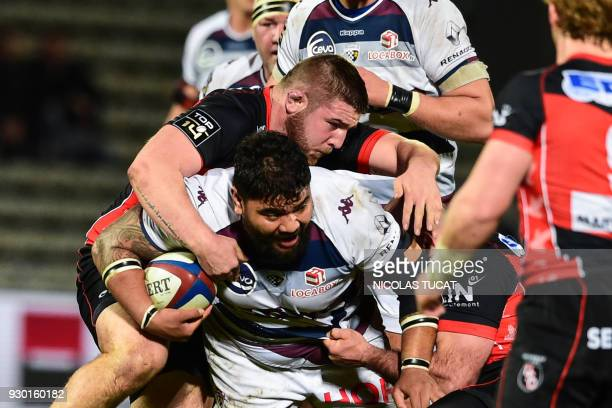 BordeauxBegles' French prop Sebastien Taofifenua is tackled during the French Top 14 rugby union match between BordeauxBegles and Oyonnax on March 10...