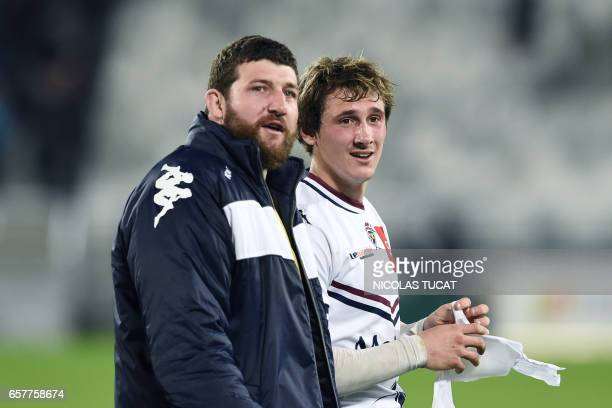 BordeauxBegles' French scrumhalf Baptiste Serin and BordeauxBegles' French hooker Clement Maynadier react at the end of the French Top 14 rugby union...