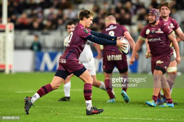 BordeauxBegles' French scrumhalf Baptiste Serin kicks the ball during the French Top 14 rugby union match between BordeauxBegles and Toulouse on...