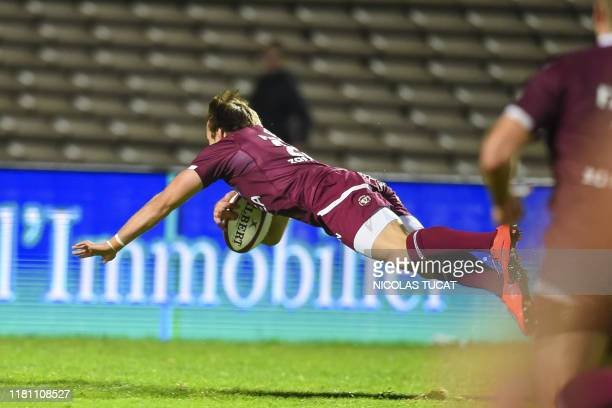 Bordeaux-Begles' French scrumhalf Yann Lesgourgues dives to score a try during the French Top14 rugby union match between Bordeaux-Begles and Agen at...