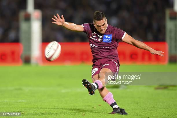 BordeauxBegles' New Zealand flyhalf Ben Botica kicks the ball during the French Top 14 rugby union match between Union BordeauxBegles and ASM...