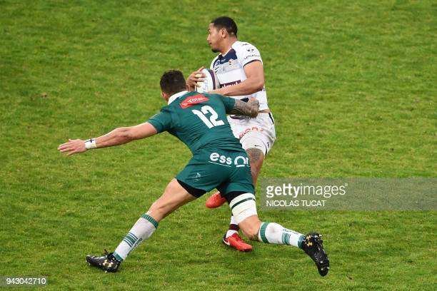 BordeauxBegles' Samoan winger Ed Fidow is tackled during the French Top 14 rugby union match between BordeauxBegles and Pau on April 7 2018 at the...