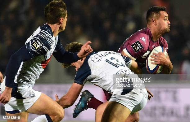 BordeauxBegles' Samoan winger Ed Fidow runs with the ball as he is tackled by Agen's player during the French Top 14 rugby union match between...
