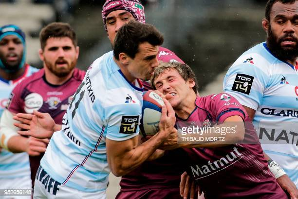 Bordeaux-Begles scrum-half Baptiste Serin tries to rip the ball from Racing 92's Argentinian winger Juan Imhoff during the French Top 14 rugby union...
