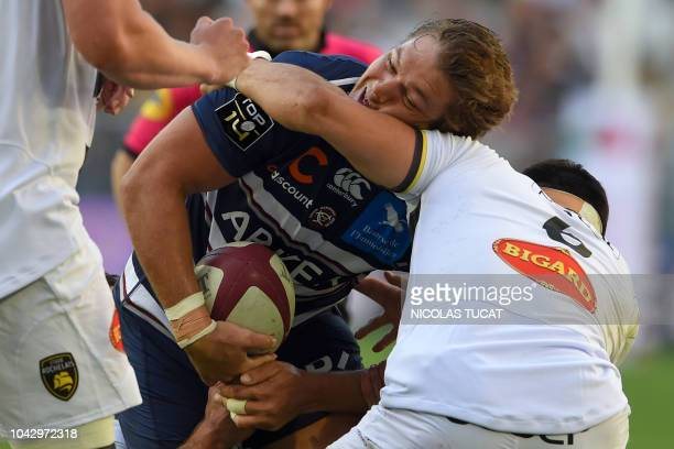 BordeauxBegles' South African lock Jandre Marais is tackled during the French Top 14 rugby union match between BordeauxBegles and La Rochelle on...