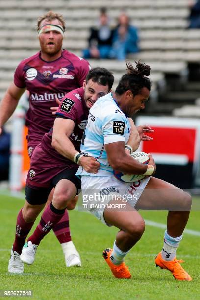 BordeauxBegles's centre JeanBaptiste Dubie tackles Racing 92's wing Teddy Thomas during the French Top 14 rugby union match BordeauxBegles vs Racing...