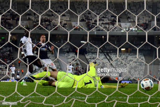 Bordeaux's Argentinian midfielder Valentin Vada scores a goal during the French Ligue 1 football match between Bordeaux and Metz on April 8 2017 at...
