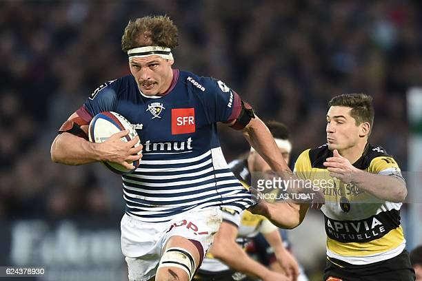 Bordeaux's Australian lock Luke Jones runs with the ball during the French Top 14 rugby union match between Bordeaux and La Rochelle at the...