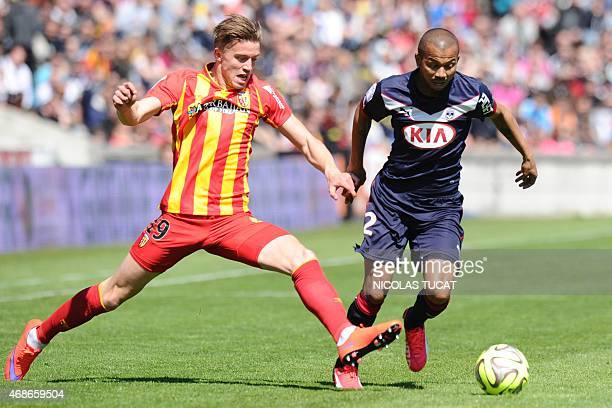 Bordeaux's Brazilian defender Mariano vies with Lens' French forward Baptiste Guillaume during the French L1 football match Girondins de Bordeaux vs...