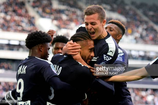 Bordeaux's Brazilian defender Pablo celebrates with Bordeaux's French forward Nicolas De Preville after scoring a goal during the French L1 football...