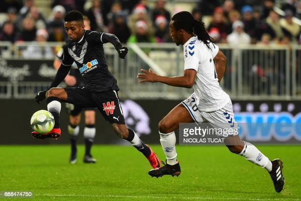 Bordeaux's Brazilian forward Jonathan Cafu controls the ball next to Strasbourg defender Bakary Kone during the French Ligue 1 football match between...
