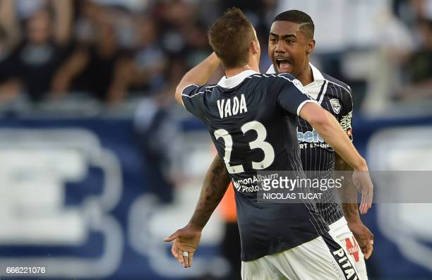 Bordeaux's Brazilian forward Malcom celebrates after scoring a goal during the French L1 football match between Bordeaux and Metz on April 8 at the...