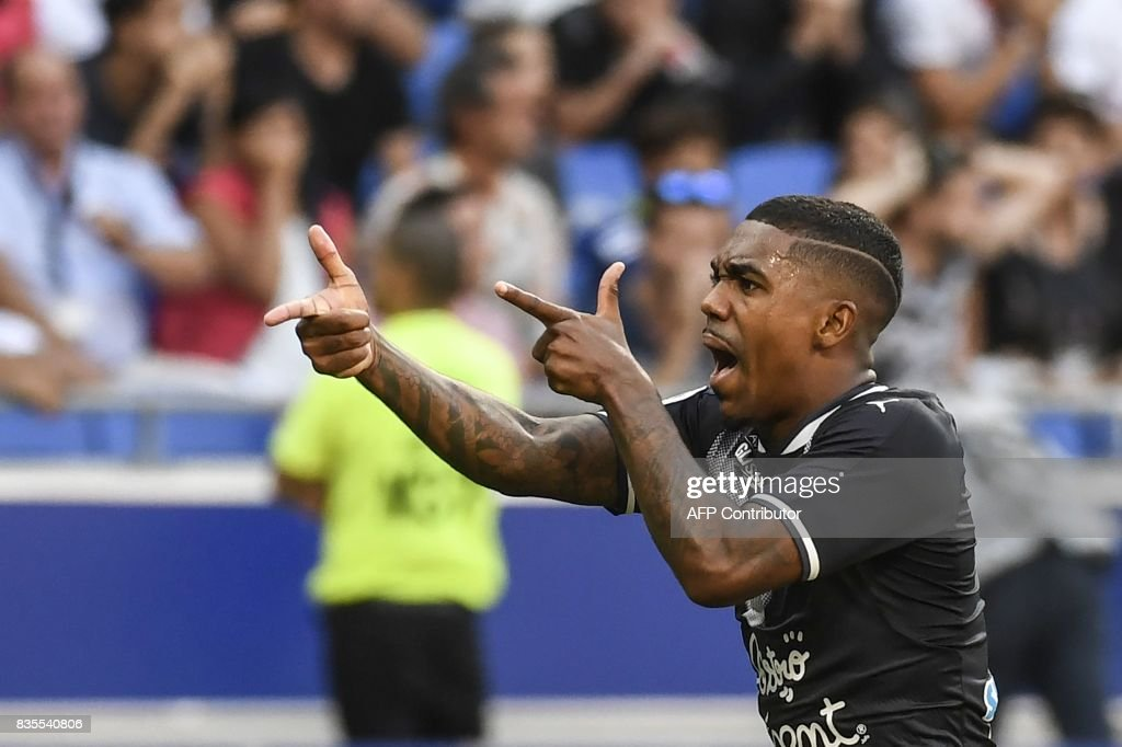 Bordeaux's Brazilian forward Malcom celebrates after scoring a goal during the L1 football match Olympique Lyonnais (OL) vs FC Girondins de Bordeaux (FCGB), on August 19, 2017 at the Groupama stadium in Décines-Charpieu near Lyon, southeastern France. /