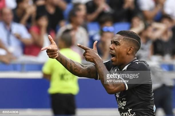 Bordeaux's Brazilian forward Malcom celebrates after scoring a goal during the L1 football match Olympique Lyonnais vs FC Girondins de Bordeaux , on...