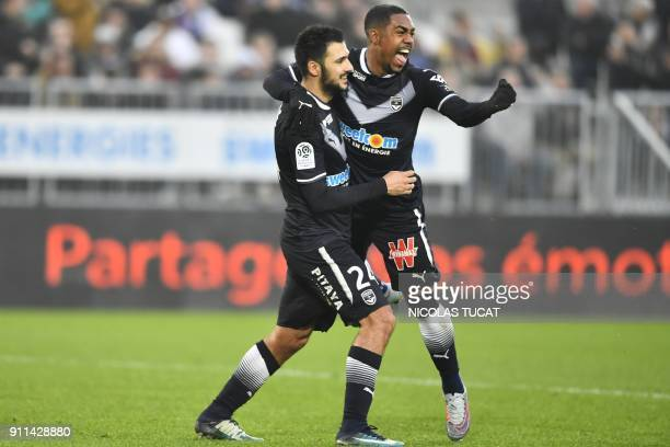 Bordeaux's Brazilian forward Malcom celebrates with Bordeaux's French forward Gaetan Laborde after scoring during the French L1 football match...