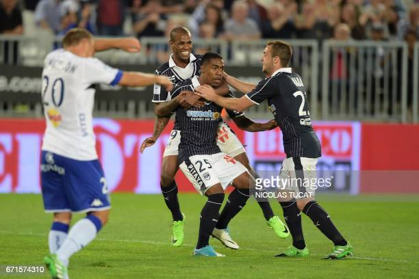 Bordeaux's Brazilian forward Malcom celebrates with teammates after scoring a goal during the French Ligue 1 football match between Bordeaux and...