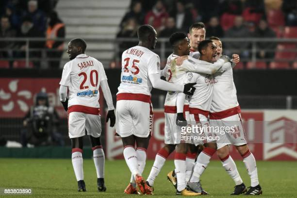 Bordeaux's Brazilian forward Malcom celebrates with teammates after scoring a goal during the French L1 football match between Dijon and Bordeaux at...