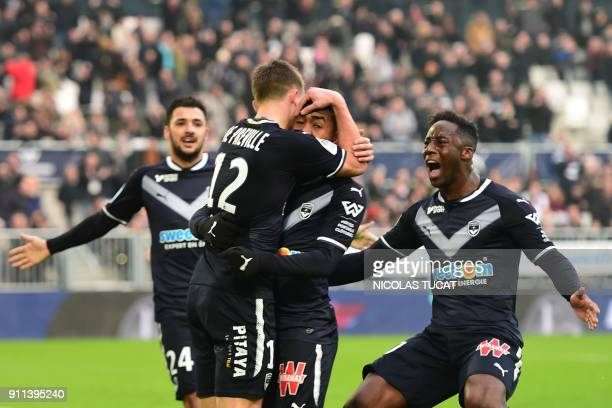 Bordeaux's Brazilian forward Malcom celebrates with teammates after scoring a goal during the French Ligue 1 football match between Bordeaux and Lyon...