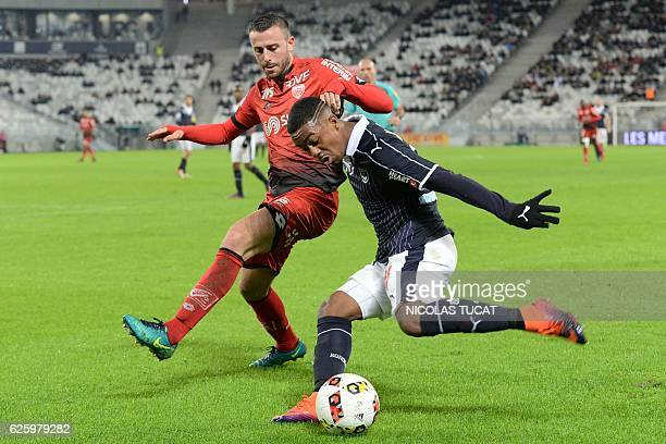 Bordeaux's Brazilian forward Malcom challenges Dijon's French defender Yunis Abdelhamid during the French L1 football match between Bordeaux and...
