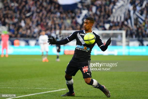 Bordeaux's Brazilian forward Malcom controls the ball during the French L1 football match between Bordeaux and Rennes on March 17 at the Matmut...
