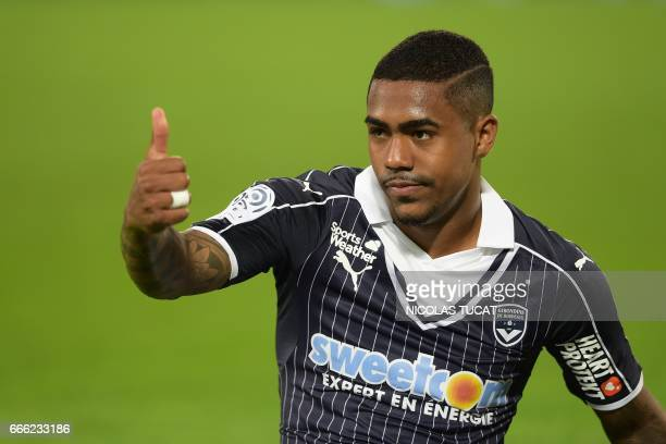 Bordeaux's Brazilian forward Malcom gestures during the French Ligue 1 football match between Bordeaux and Metz on April 8 2017 at the Matmut...