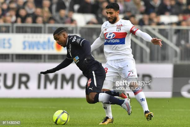 Bordeaux's Brazilian forward Malcom is fouled by Lyon's French midfielder Nabil Fekir during the French L1 football match between Bordeaux and Lyon...