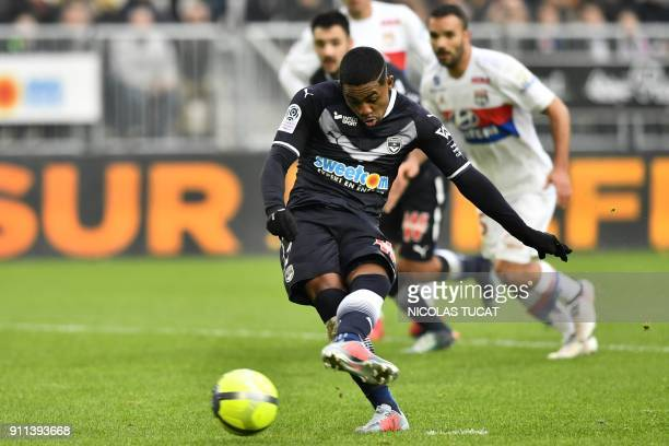 Bordeaux's Brazilian forward Malcom kicks the ball for a penalty to score during the French Ligue 1 football match between Bordeaux and Lyon on...