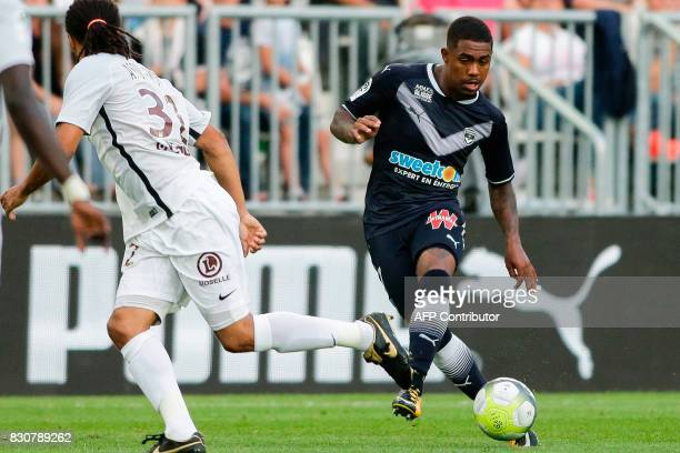 Bordeaux's Brazilian forward Malcom passes the ball during the French L1 football match Bordeaux vs Metz on August 12 2017 at the Matmut Atlantique...