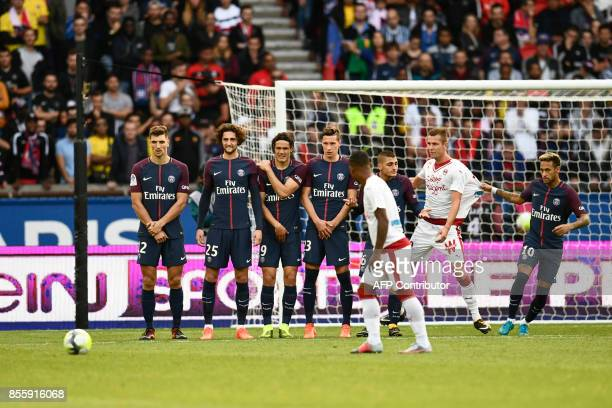Bordeaux's Brazilian forward Malcom prepares to shoot a free kick as Paris SaintGermain's Brazilian forward Neymar pulls the jersey of Bordeaux's...