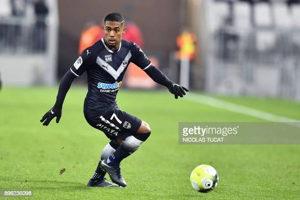 Bordeaux's Brazilian forward Malcom runs with the ball during the French L1 football match between Bordeaux and Montpellier on December 20 at the...