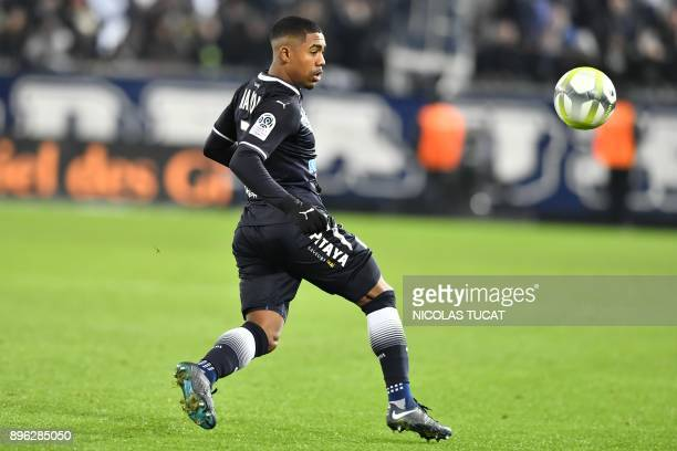 Bordeaux's Brazilian forward Malcom runs with the ball during the French L=1 football match between Bordeaux and Montpellier on December 20 2017 at...