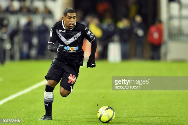 Bordeaux's Brazilian forward Malcom runs with the ball during the French L1 football match between Bordeaux and Caen on January 16 2018 at the Matmut...