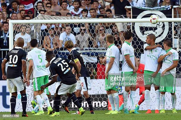 Bordeaux's Brazilian forward Malcom scores a goal during the French L1 footbal match between Bordeaux and SaintEtienne on August 13 2016 at the...
